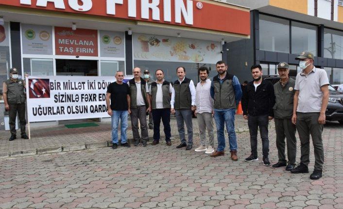 Muğla'da orman yangını söndürme çalışmalarına destek veren Azerbaycanlı itfaiyeciler, Trabzon'da coşkuyla karşılandı