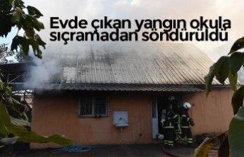 Evde çıkan yangın okula sıçramadan söndürüldü
