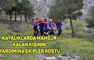 Kayalıklarda mahsur kalan kişinin yardımına ekipler...